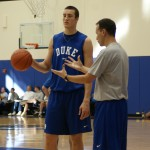 Duke Assistant Coach Chris Collins instructs freshman Mile Plumlee in practice.