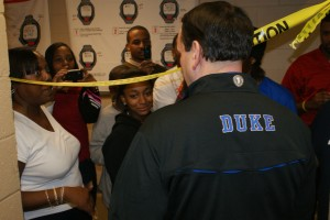When Coach K attends events, he watches the games intensely, but he took time for some autographs from fans