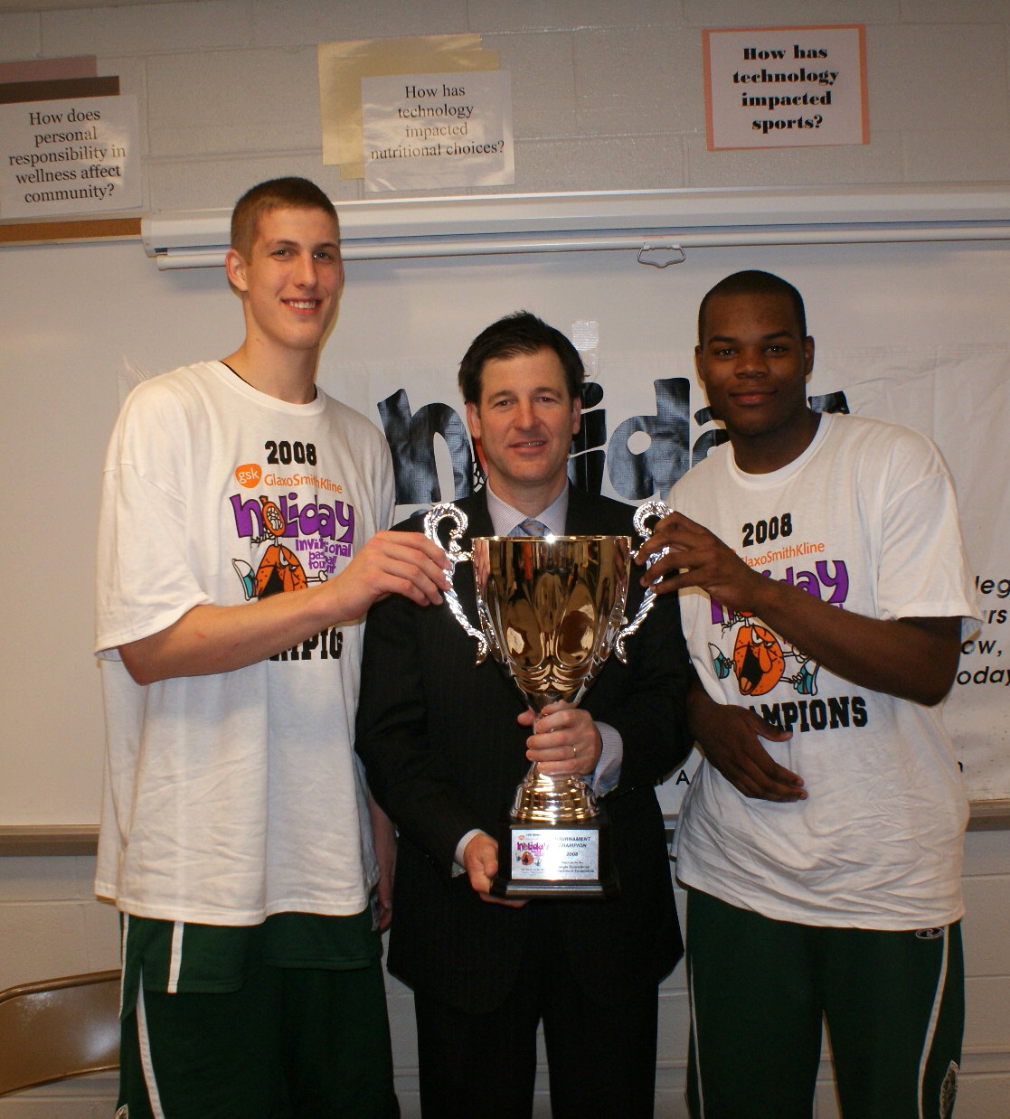 Mason Plumlee, Coach David Gaines and Lakeem Jackson hold up the Glaxo Championship trophy