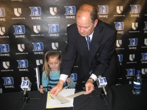 Cutcliffe spends time with his youngest daughter during his initial signing day
