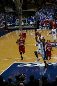 Henderson drives in for a dunk after an assist from McClure, helping Duke to a 73-58 win over N.C. State on Tuesday evening.