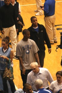 Barnes in his Duke T-Shirt walks off the court with Josh Hairston to enter the Duke locker room after the game