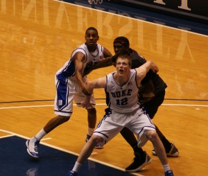 Singler and Williams battle for a rebound - BDN Photo