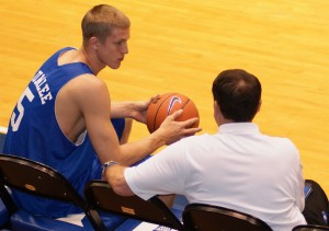 Plumlee confers with Coach K - copyright Blue Devil Nation Photo