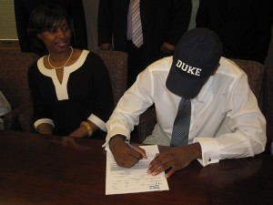 Tyler Thornton puts pen to paper to officially become a future Blue Devil - Photo courtesy of Real Thornton pictured left.