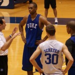 Lance Thomas listens to Coach K during a Duke practice - BDN Photo