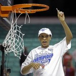 Jasmine Thomas and Duke cut the nets