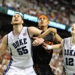 Zoubs and Scheyer battle for a board vs Miami, Lance King Images