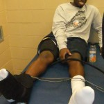 West Virginia's Darryl Bryant gets treatment on Friday.  The burning question is will he play in the Duke game.