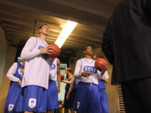 Duke freshman Mason Plumlee and Andre Dawkins survey the court befor the Blue Devils open practice on Saturday. BDN Photo