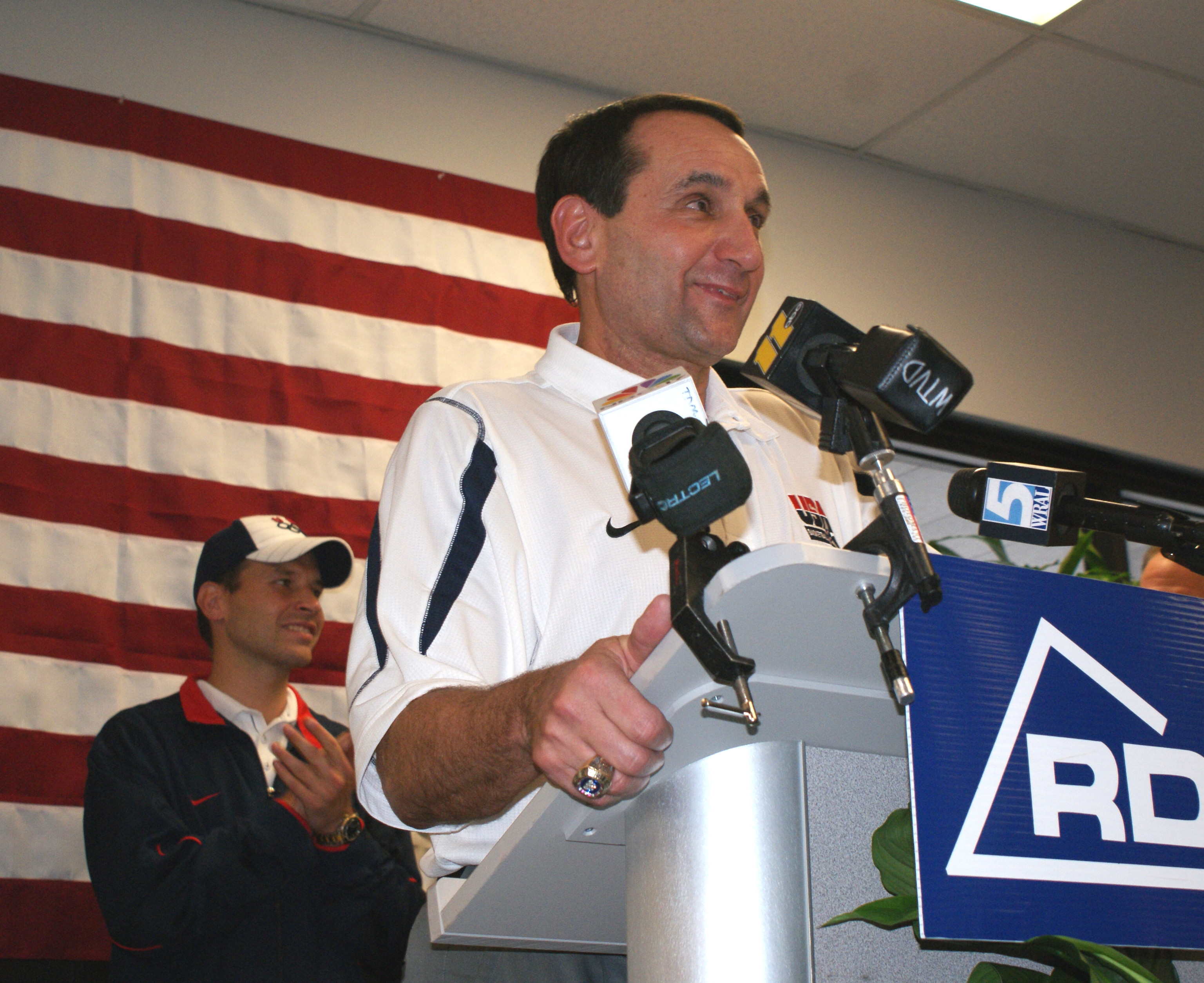 When Krzyzewski helped return Gold for Team USA there was a sense of relief.  In this picture Coach addresses fans at RDU upon his return and there is a big smile on his face.  The smile was there again during his annual summer press conference where he addressed the state of affairs on all things Duke and USA Basketball. - BDN Photo