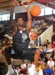 UNC fans saw there future in Harrison BArnes who dunks during the opening night of the NC Pro Am - Rick Crank, BDN Photo is copyrighted