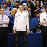 Duke coaches Chris Collins and Nate James flank prospect Alex Murphy, middle, during the pre-game warm ups vs Maryland.  Murphy is a key Duke target and you can read more about his recruitment on BDN Premium, our subscription service which grants full site access.  Photo copyright Lance King of Lance Images for BDN.