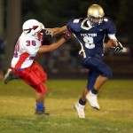 Jaleel Dukes breaks a tackle