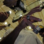 Pictured, media surrounding Coach K and the ring of champions.  BDN Photo