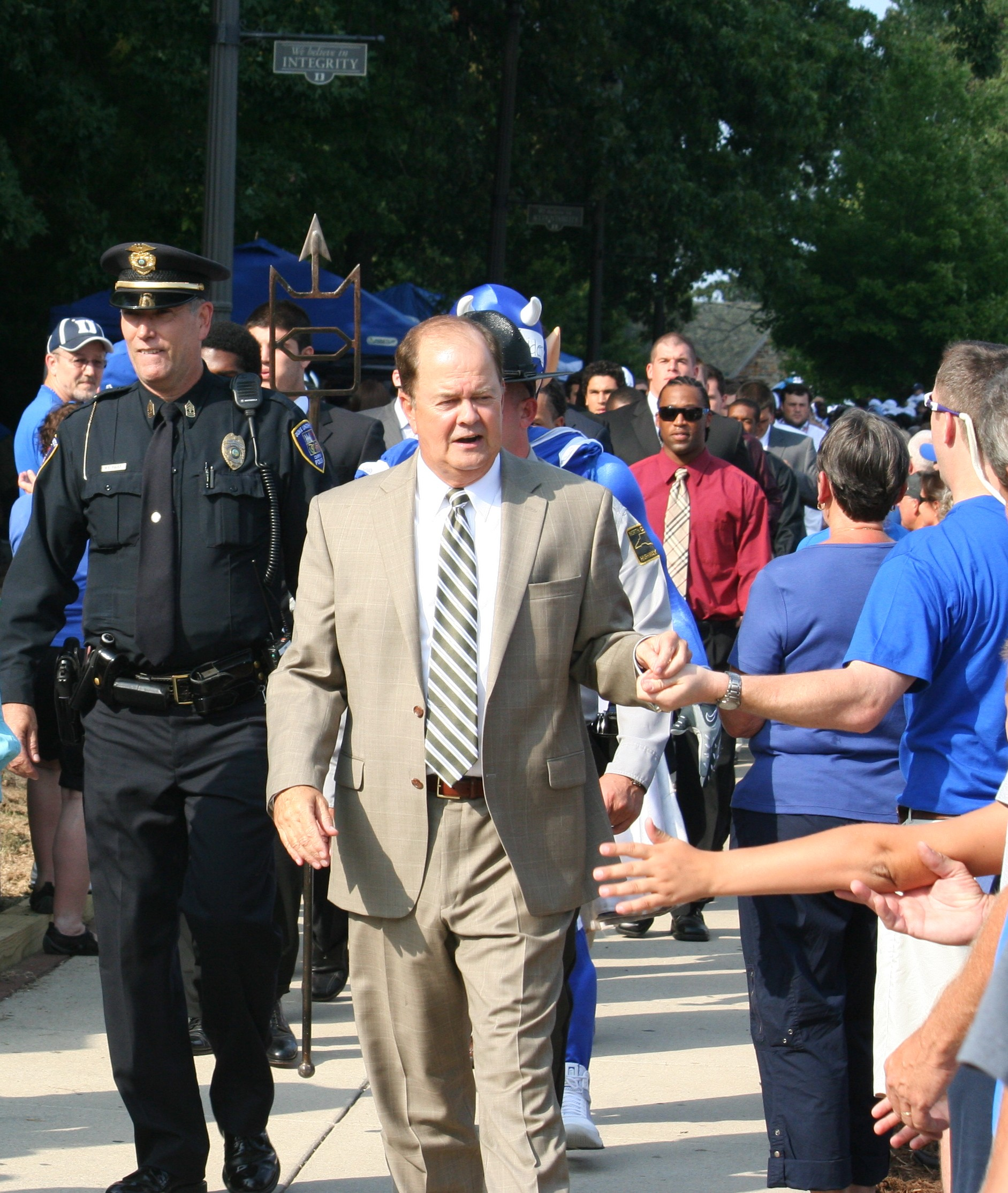 Coach Cutcliffe and the team will kickoff the festivities with the Blue Devil Walk at 11AM Saturday- BDN Photo