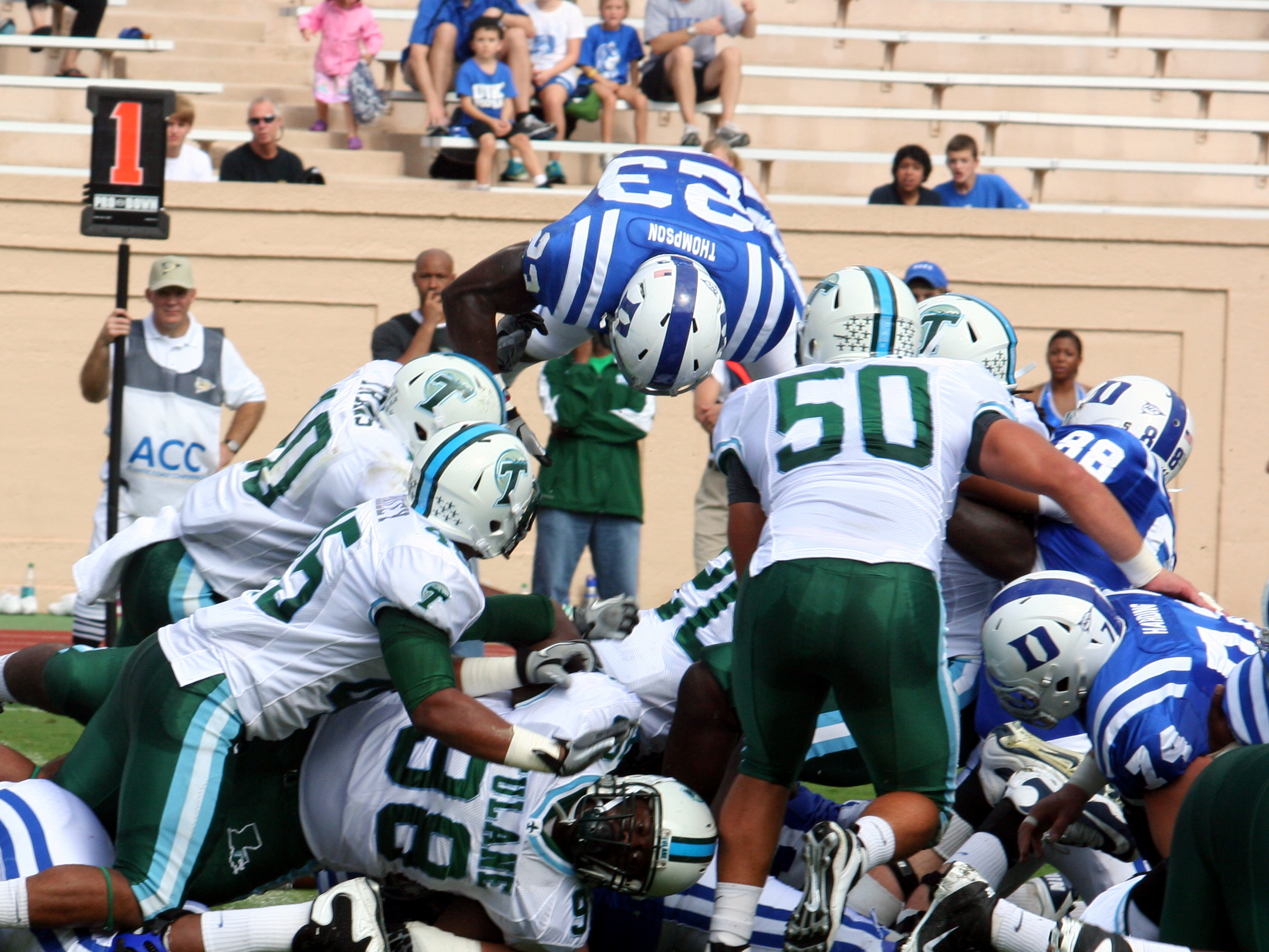 Duke RB Juwan Thompson leaps the pile for the touchdown against Tulane -BDN Photo