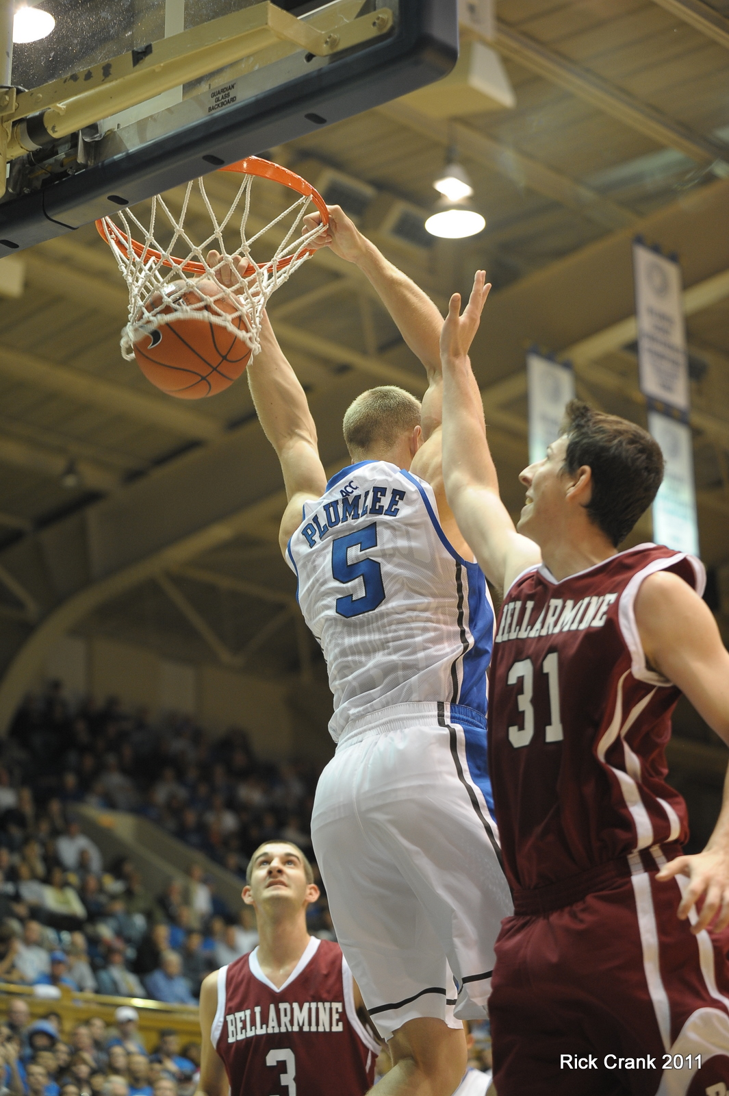 Mason slams one in vs Bellarmine - copyright BDN Photo