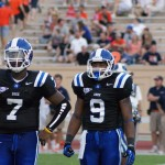 Anthony Boone flanked by Josh Snead during the Blue Devils 42-17 win over Virginia on Saturday.